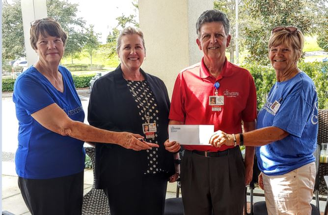 Members-of-Clerbrook-RV-Resort-present-gift-to-Cornerstone-Hospice