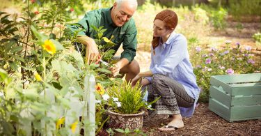 man-and-woman-outside-gardening