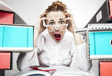 businessowman-stressing-over-office-work-frustrated