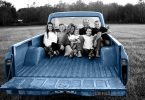 family-sitting-in-truck