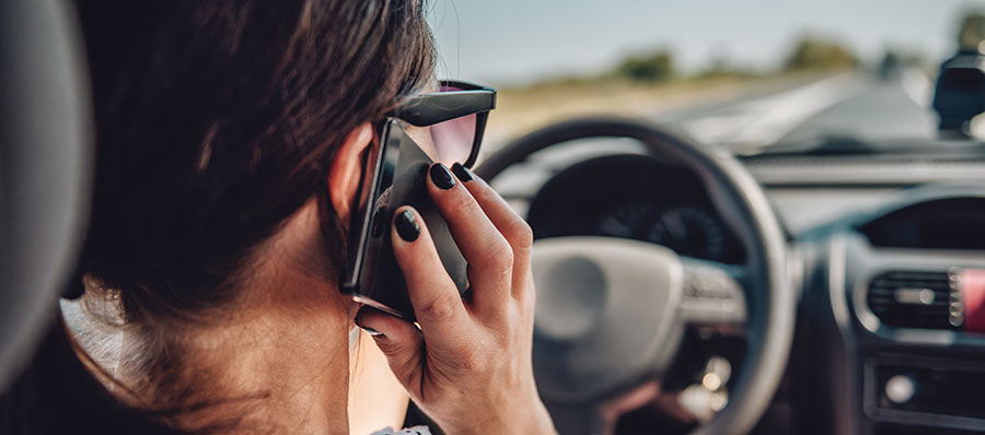woman-talking-on-phone-while-driving