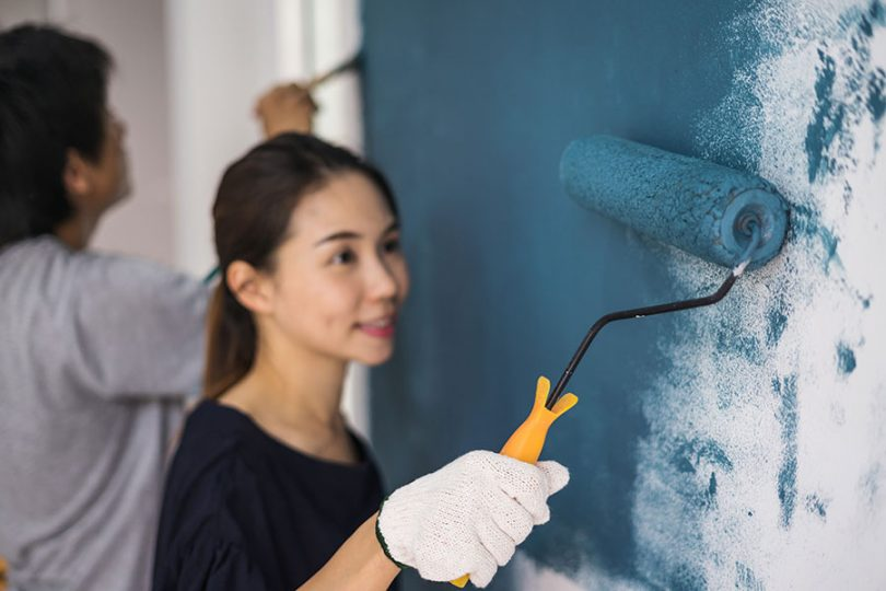 woman-painting-wall