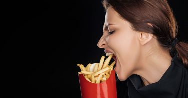 woman-eating-fries