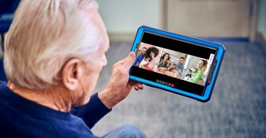 senior-man-holding-tablet